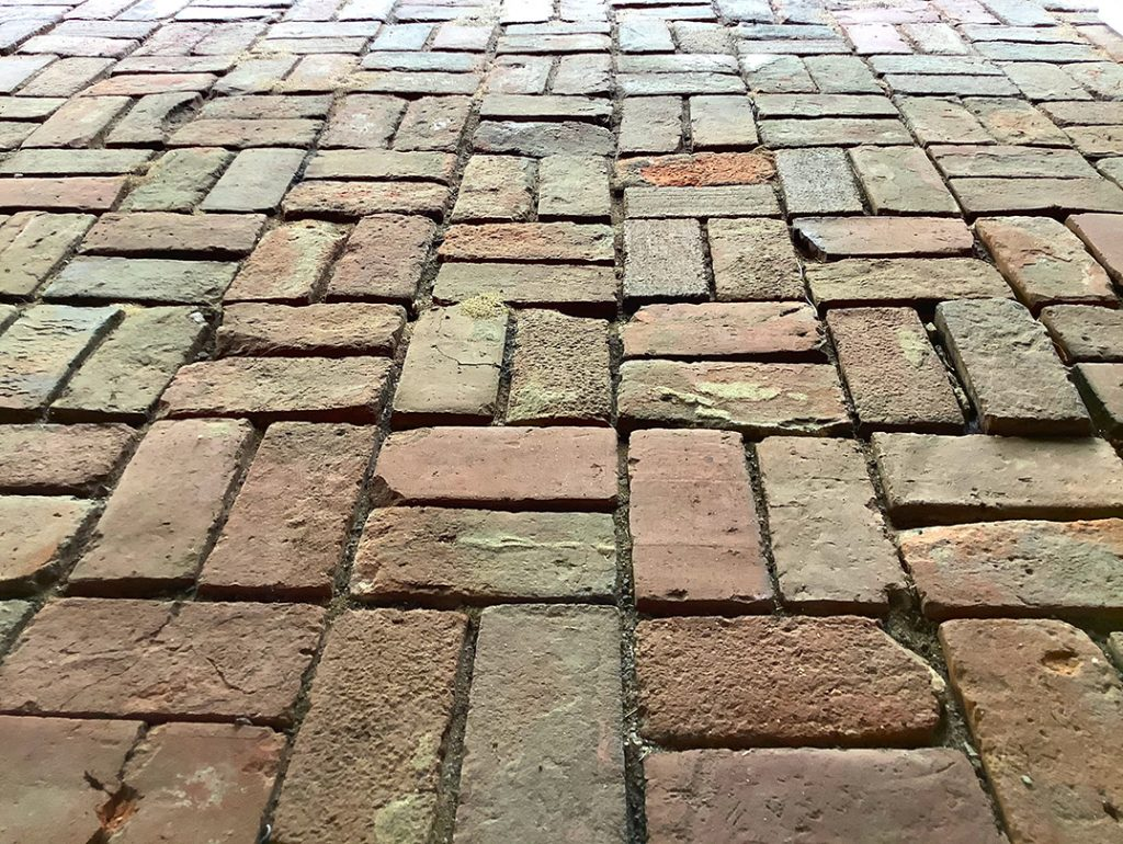 Worn bricks on a path or road leading forward show what bps Captura has set out to do